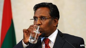Newly appointed Maldives President Mohamed Waheed has a drink during a press conference at his office in Male on February 8, 2012.