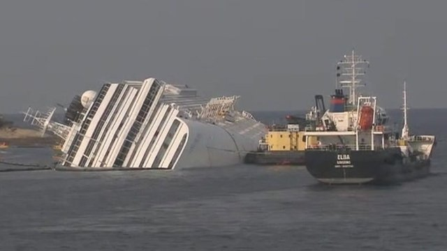 Costa Concordia and barges
