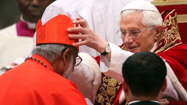 New cardinal George Alencherry receives the biretta cap from Pope Benedict