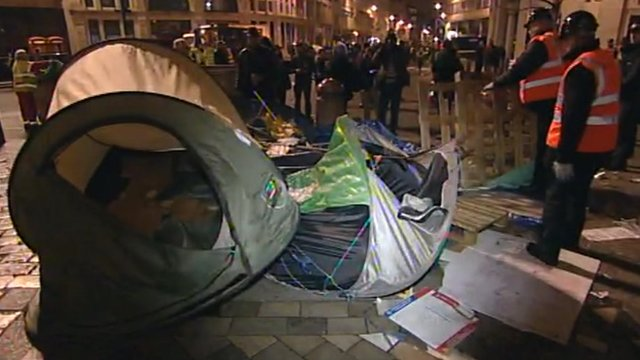 Bailiffs removing tents and pallets
