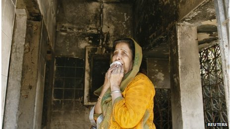 A survivor inside her home that was burnt in the riots in the western Indian city of Ahmedabad February 27, 2012