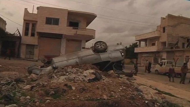 Upturned car in the northern Syrian town of Sarmin