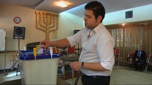 A Jewish man votes in Iran's parliamentary elections