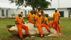 Workers in Ivory Coast outside their cashew nut factory.