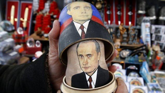 A traditional Matryoshka doll bearing the faces of Vladimir Putin (bottom) and Dmitry Medvedev.