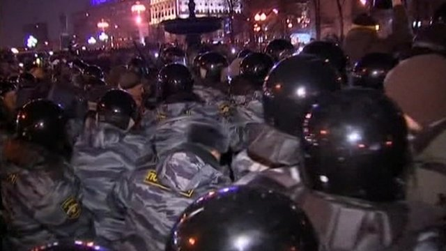 Police scrum in response to demonstrations in Moscow.