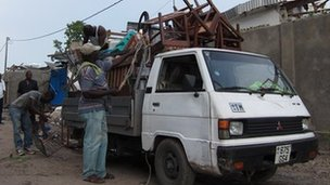 Congolese people load up furniture onto the back of lorries after a series of explosions rocked the capital Brazzaville on 4 March 2012