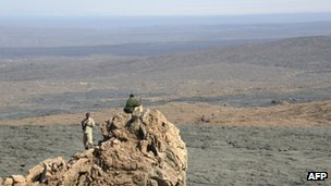 Police standing guard on Erta Ale volcano [February 2005]