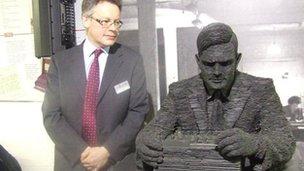 Sir John Dermot Turing and statue of Alan Turing
