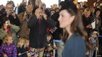 Dozens of bystanders take photos of the Duchess of Cambridge at Leicester Station