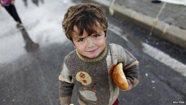 Boy refugee at camp on Turkish-Syrian border