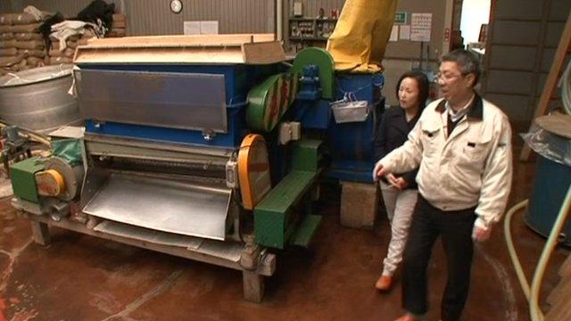 Kaichiro Saito leads Mariko Oi into sake factory