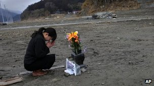 Survivor Mika Hashikai mourns her father, killed in the tsunami in Rikuzentakata (photo: 11 March 2012)