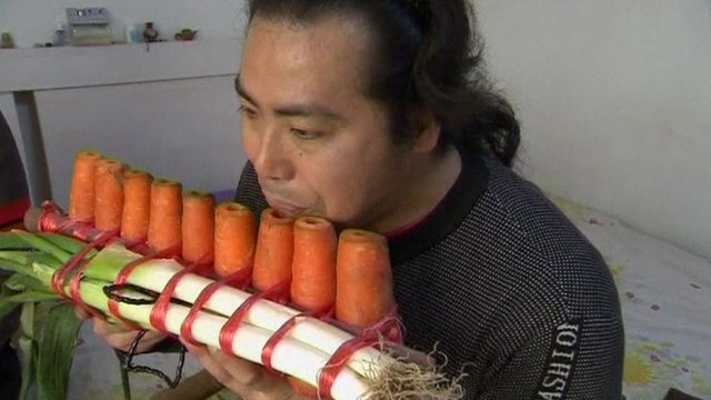 A musician with an instrument made from carrots