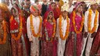 Boys and girls in Vadia village, Gujarat state, India, pose for pictures after their engagement ceremony 11 March 2012