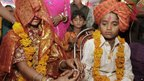 A boy and girl take part in their engagement ceremony in the village of Vadia, Gujarat state - 11 March 2012