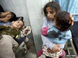 Wounded children in a hospital in northern Gaza after an Israeli air strike (12 March 2012)