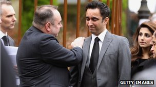 Alex Salmond comforts Mr McBride's friend and colleague Aamer Anwar