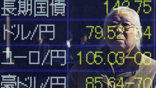 An electronic board displaying foreign currency rates in Tokyo.