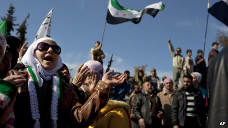 A woman chants a slogan during an anti-government protest in northern Syria (2 March 2012)