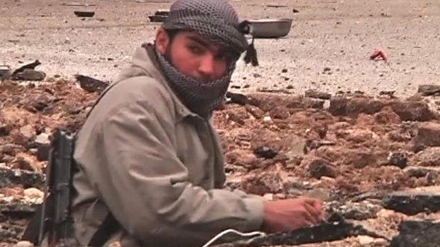 Man laying street explosives in Idlib