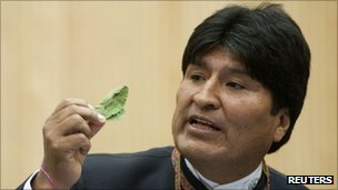 Bolivian President Evo Morales holds a coca lead as he addresses the UN drugs commission in Vienna, 12 March