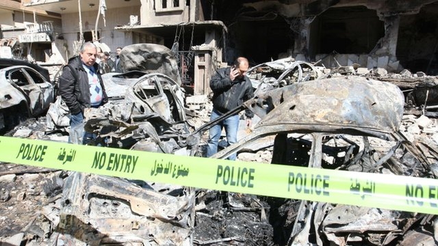 Syrian security officers survey the scene