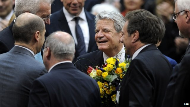 Joachim Gauck being congratulated by politicians in Germany's parliament