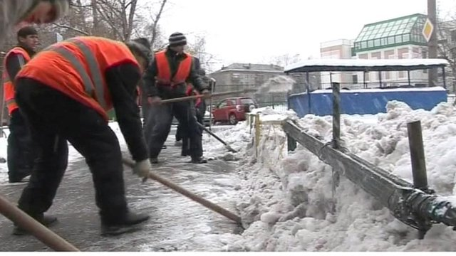 Tajik workers cleaning Moscow streets.