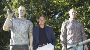 Rower Steve Redgrave standing beside his statue in Henley