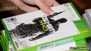 A gamer picks up a copy of Call of Duty