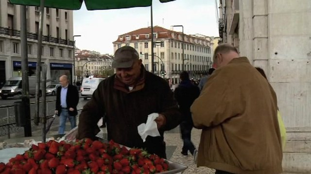 A man selling strawberries
