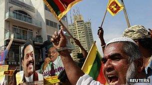 A supporter of Sri Lanka's President Mahinda Rajapaksa protests against the Geneva meeting