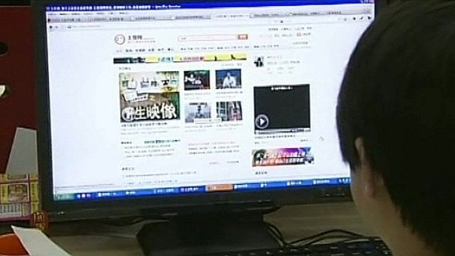 A young man looking at a website
