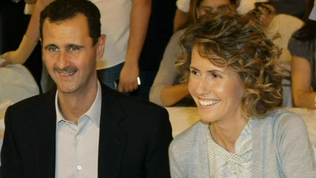 President Assad of Syria smiling with his wife Asma.