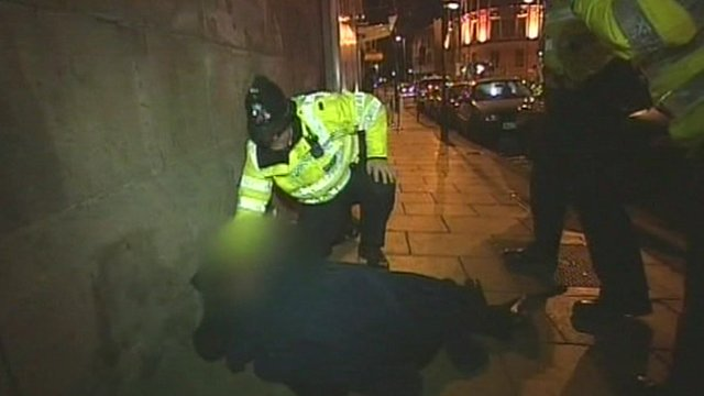 Policeman aids man
