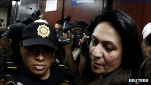 Former Guatemalan police chief Marlene Blanco escorted by police officers after her arrest