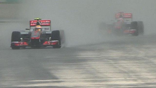 Lewis Hamilton leads Jenson Button in Malaysia