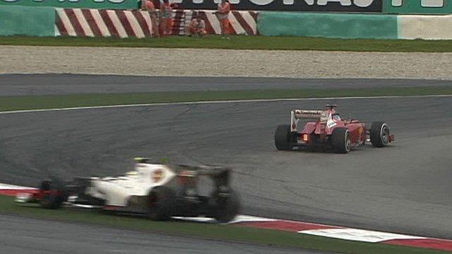 Sergio Perez runs wide