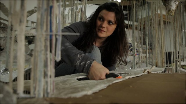 Artist Diana Al-Hadid works on one of her sculptures.