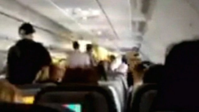 Footage appears to show the scene inside the plane