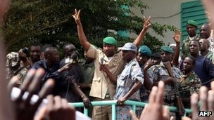 An unidentified leader of the March 22 Popular Movement addresses thousands marching in Bamako in support of Mali's coup leaders