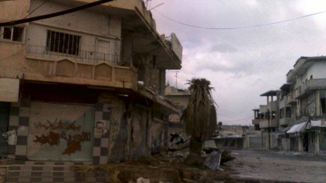 A damaged building in Al Qasseer city, near Homs