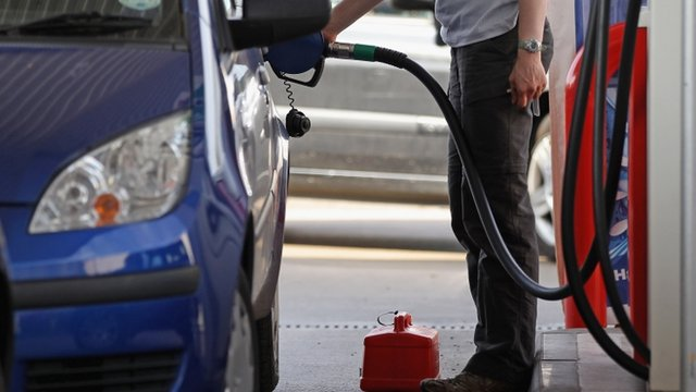 Man filling car with fuel
