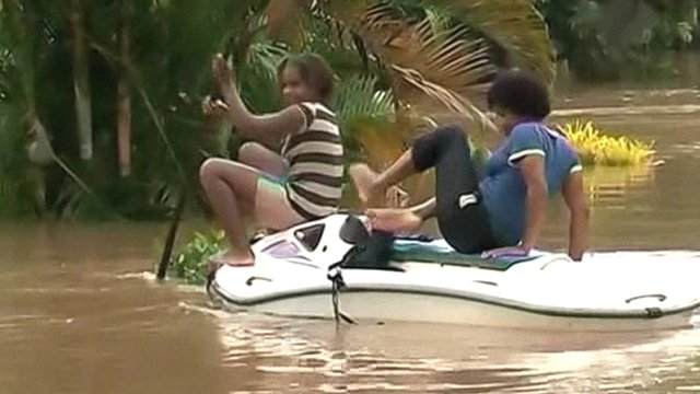 People on a boat in flooded Fiji