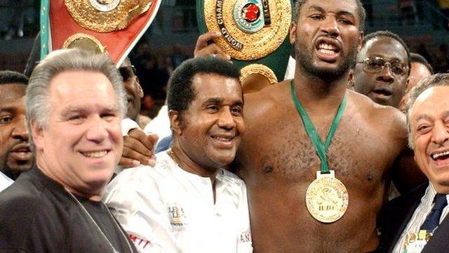 Archive: Emanuel Steward celebrates with former heavyweight champion Lennox Lewis