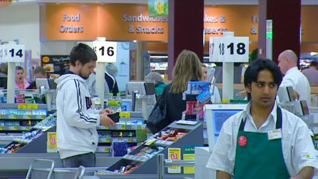 Workers in Morrisons supermarket