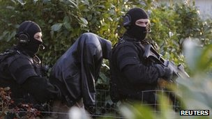French special forces escort a suspect arrested in Coueron, near Nantes, 30 March