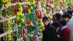 Chinese people visit their family graves at the Babaoshan Cemetery during Qingming Festival in Beijing, 4 April 2012