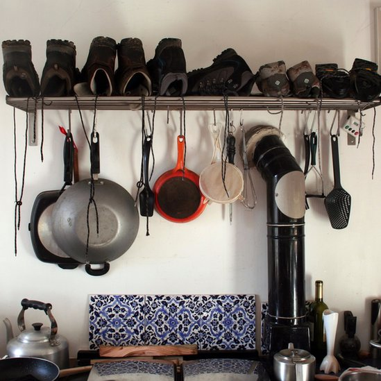 Boots drying in a kitchen